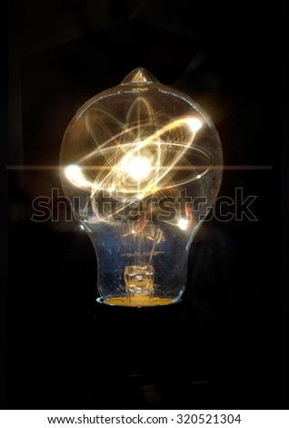 Atomic particle as lightbulb filament for nuclear energy imagery - stock photo