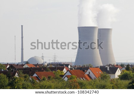 Atomic power plant not far away from a residential area. - stock photo
