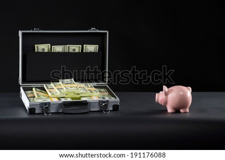 Attache full of money. A classic type suitcase full of 100$ bills money packs. - stock photo
