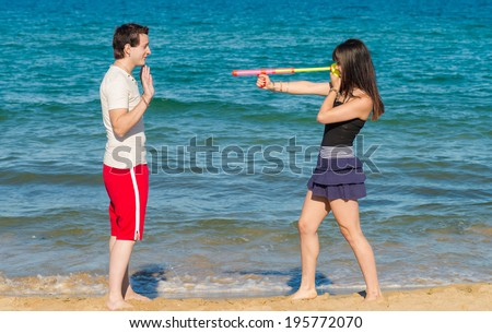 Attacking him with a  dangerous summertime weapon - stock photo