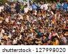 ATTARI, INDIA - OCTOBER 18: Indian celebrating at the Indian - Pakistani border during the border closing ceremony at October 18, 2012 in Attari, Punjab, India. - stock photo