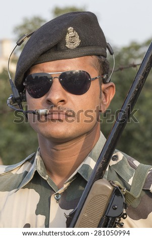 ATTARI, INDIA - SEPTEMBER 29, 2014: Unknown Indian frontier guard at the Indian - Pakistani border during the border closing ceremony - stock photo
