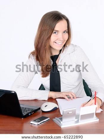 attentive businesswoman signing document - stock photo