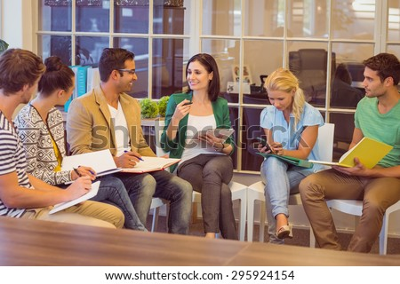 Attentive creative business people in meeting at office - stock photo