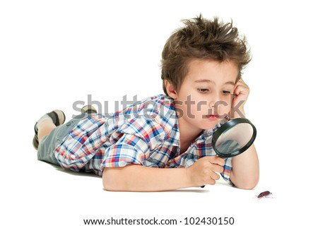 Attentive little boy with weird hair researching the bug using magnifier isolated on white - stock photo