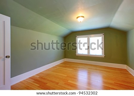 Attic small green room with double window. - stock photo