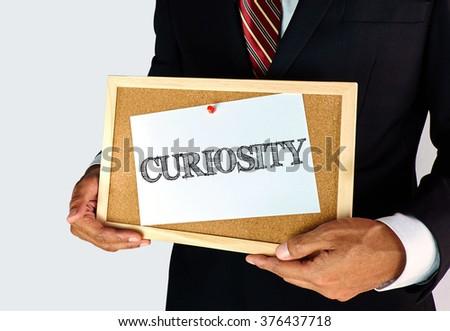 Attitude and Motivation concept - Curiosity - stock photo