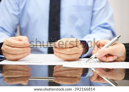attorney is commenting contract so client can understand consequences - stock photo