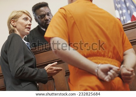 Attorney Speaking to Defendant and Judge - stock photo