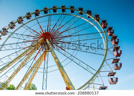 Attraction ferris wheel on a background of clear sky on a summer day