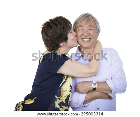 Attractive Affectionate Senior Chinese Couple Isolated on a White Background. - stock photo