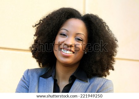 Attractive African American Business Professional Business Woman Happy and Cheerful Smiling - stock photo