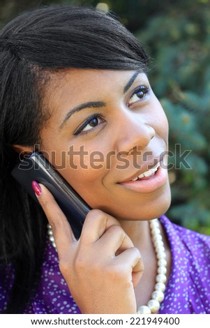 Attractive African American Business Professional Business Woman Smiling and Talking on the Phone - stock photo