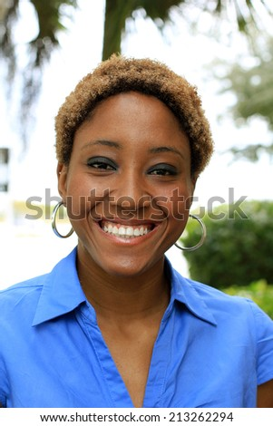 Attractive African American Business Woman Smiling and Looking At the Camera Black and Blonde Hair - stock photo