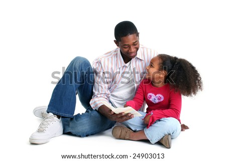 Attractive African American father and daughter reading together. - stock photo