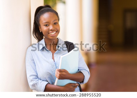 attractive african American female college student on campus - stock photo