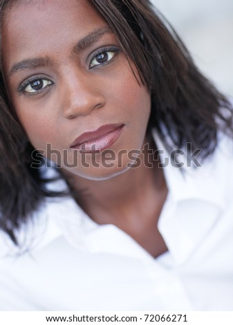 Attractive African American female posing outdoors - stock photo