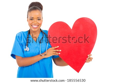 attractive african american healthcare worker with heart symbol - stock photo