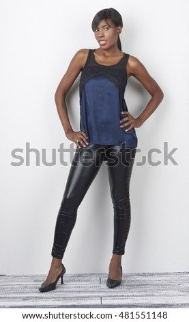Attractive African American model wearing casual clothing photographed in studio looking at camera.