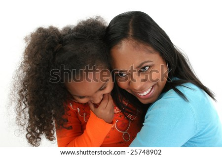 Attractive African American mother and daughter hugging. - stock photo