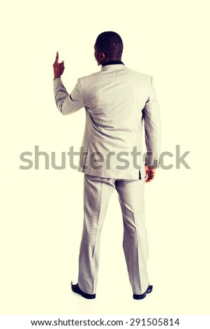 Attractive african businessman standing back