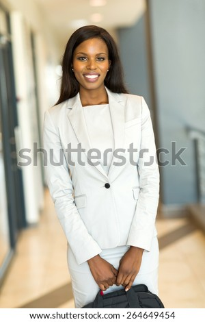 attractive african businesswoman holding briefcase - stock photo