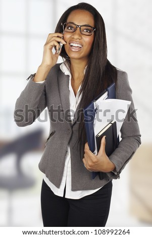 attractive african businesswoman with mobile phone at office - stock photo