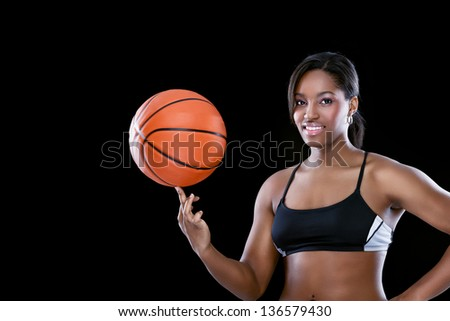Attractive African female basketball - stock photo