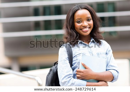 attractive african female college student on campus - stock photo