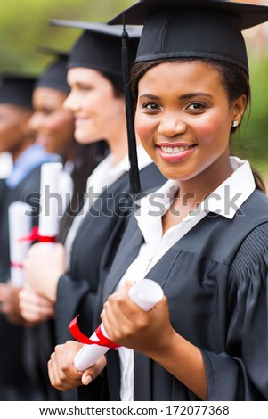 attractive african female graduate at graduation ceremony - stock photo