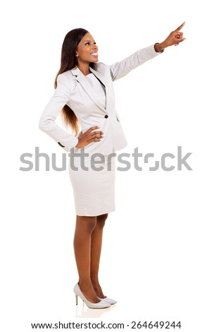 attractive african woman pointing at empty copy space - stock photo