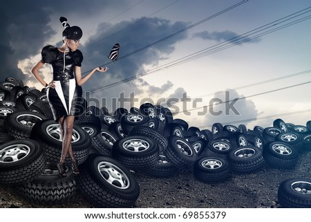 Attractive african woman with butterfy on tires on the cloudy sky - stock photo