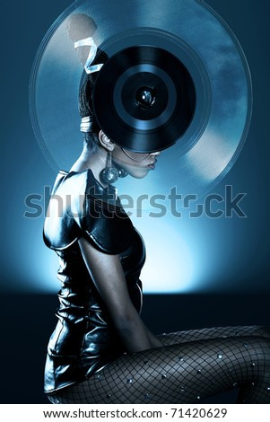 Attractive african woman with vinyl record on head - stock photo