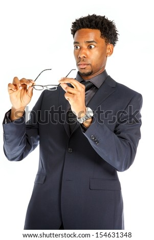 Attractive afro-american business man posing in studio isolated on a white background