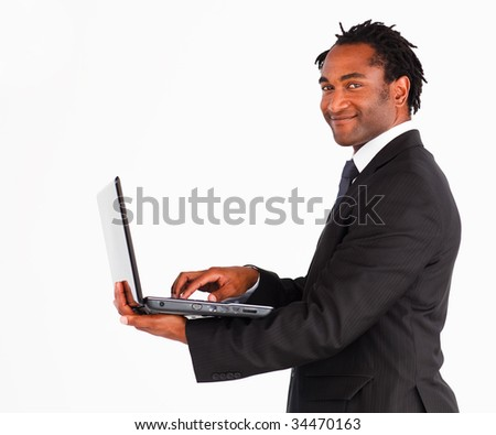 Attractive afro-american businessman with laptop looking at the camera