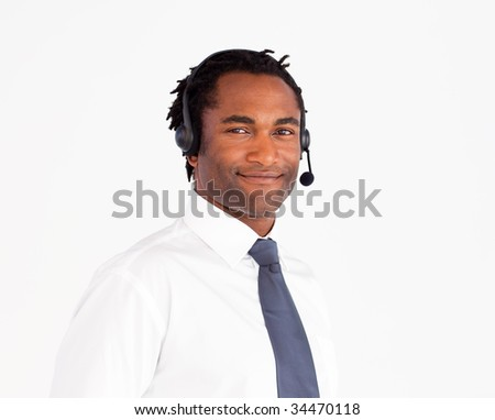 Attractive afro-american businessman working with headset on