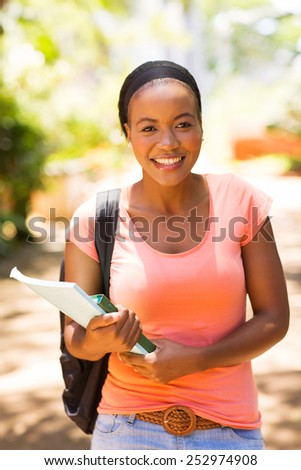 attractive afro american university student outside campus