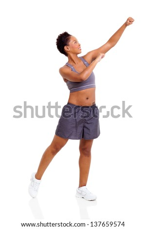 attractive afro american woman exercising on white background - stock photo