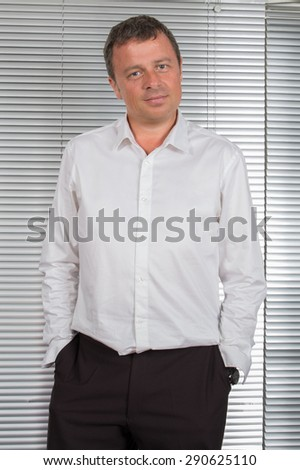 Attractive and Confident business man smiling at office