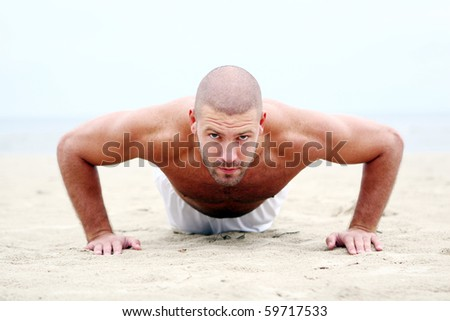 attractive and happy man on the beach