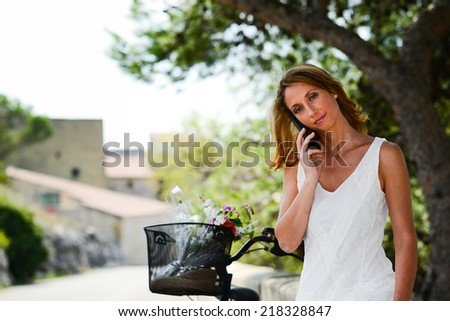attractive and romantic young woman making phone call outdoor in summer holiday vacation