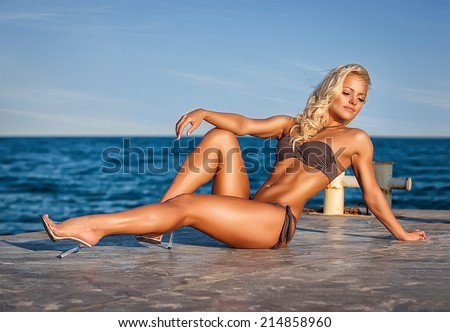 Attractive and sexy girl on the beach - stock photo
