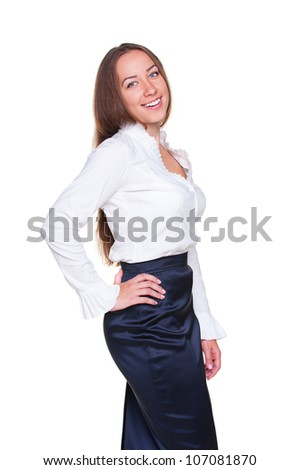 attractive and smiley businesswoman posing over white background. studio shot