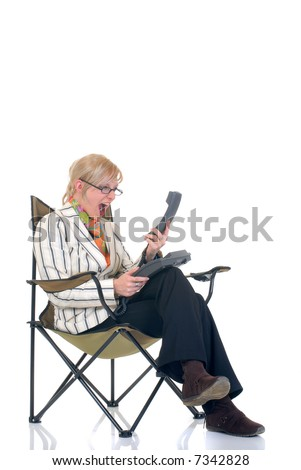 Attractive angry dissatisfied,  trendy young blond businesswoman making a phone call,  white background,
