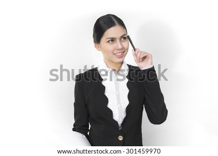 Attractive asian business women who thinking - stock photo
