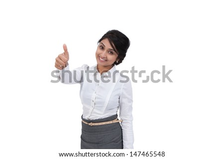 Attractive Asian businesswoman showing a thumbs up  - stock photo