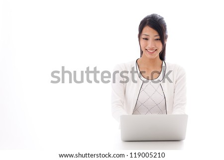 attractive asian businesswoman using laptop on white background