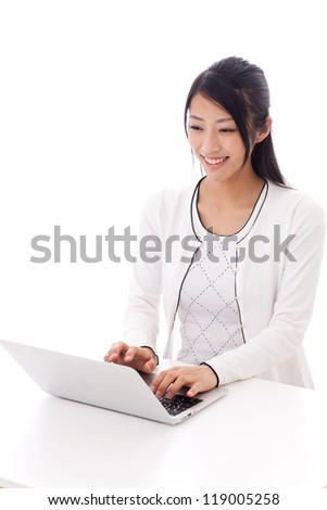 attractive asian businesswoman using laptop on white background - stock photo