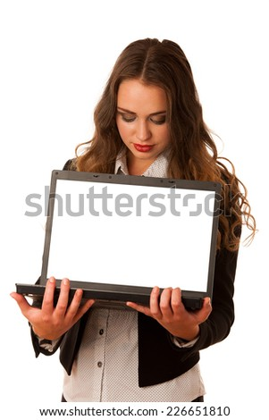 Attractive asian caucasian woman holding a laptop in her hands with blank space on monitor for additional text isolated over white background - stock photo