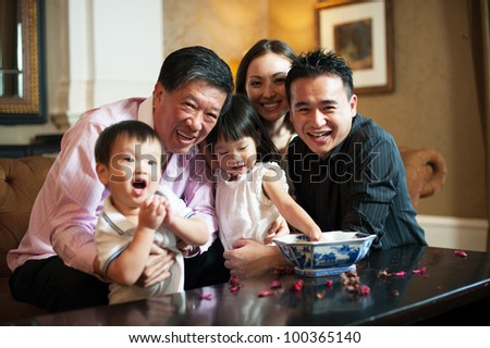 Attractive Asian Family in Lounge - stock photo